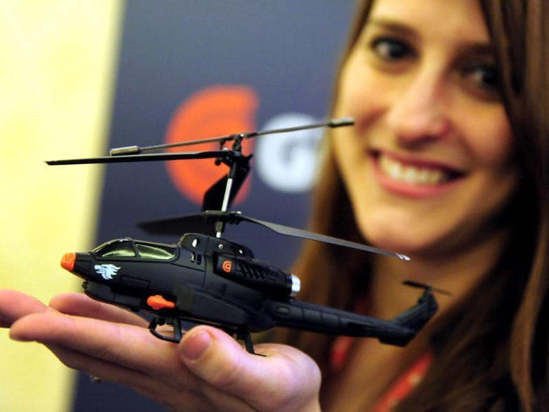Jackie Ballinger from GriffinTechnology displays the Helo TC Assault at CES Unveiled, ahead of the opening of the annual Consumer Electronics Show on January 8, 2012 in Las Vegas, Nevada. The easy-to-fly indoor remote controlled toy helicopter can be controlled with a iPhone, iPad or iPod touch and will soon be available for Android devices. AFP PHOTO