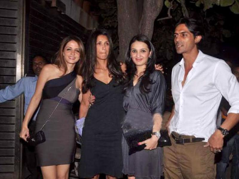 Susanne Khan poses with Arjun Rampal and Mehr Jessia.