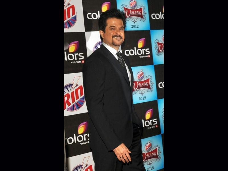 Impossible dreams: Anil Kapoor looks dapper in a black suit.