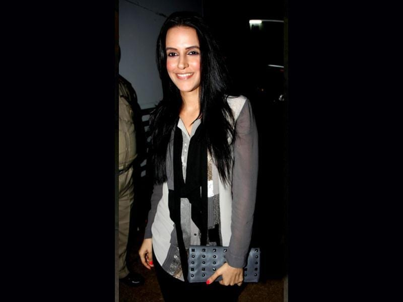 Neha Dhupia has an extra glow on her cheeks.