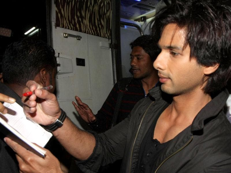 Shahid Kapoor signs an autograph.