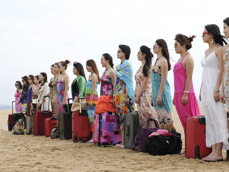 Trainees gather at the beach as they wait for the beginning of a training session for female bodyguards organised by Tianjiao Special Guard/Security Consultant Ltd. Co. in Sanya, China.(Reuters)