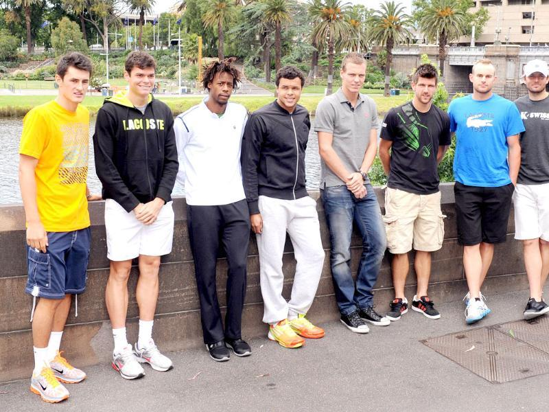 Tennis players Bernard Tomic (L), Milos Raonic (2nd-L), Gael Monfils (3rd-L), Jo-Wilfried Tsonga (4th-L), Tomas Berdych (4th-R), Jürgen Melzer (3rd-R), Andy Roddick (2nd-R) and Marty Fish (R) pose for a photo before a public event for the upcoming Kooyong Classic, in Melbourne. (AFP Photo/William West)