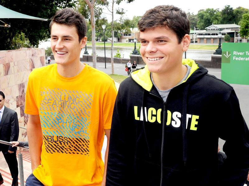 Tennis players Bernard Tomic of Australia (L) and Milos Raonic of Canada (R) arrive for a public event for the upcoming Kooyong Classic, in Melbourne. (AFP Photo/William West)