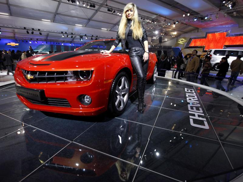 A model poses in a Chevrolet Camaro at the Auto Expo in New Delhi. AP Photo