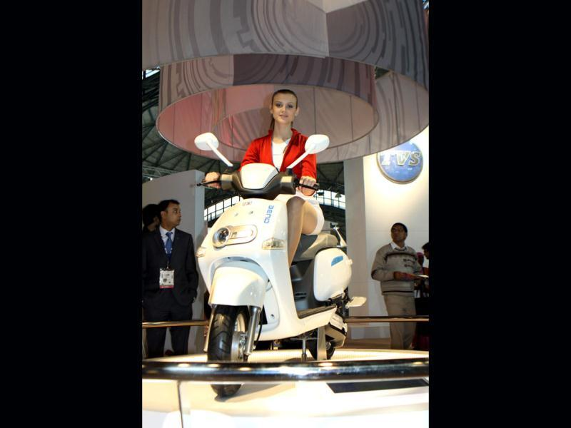 A model announces the 'Hybrid Scooter' at Auto Expo TVS Motor Company pavilion in New Delhi. HT Photo/Sonu Mehta