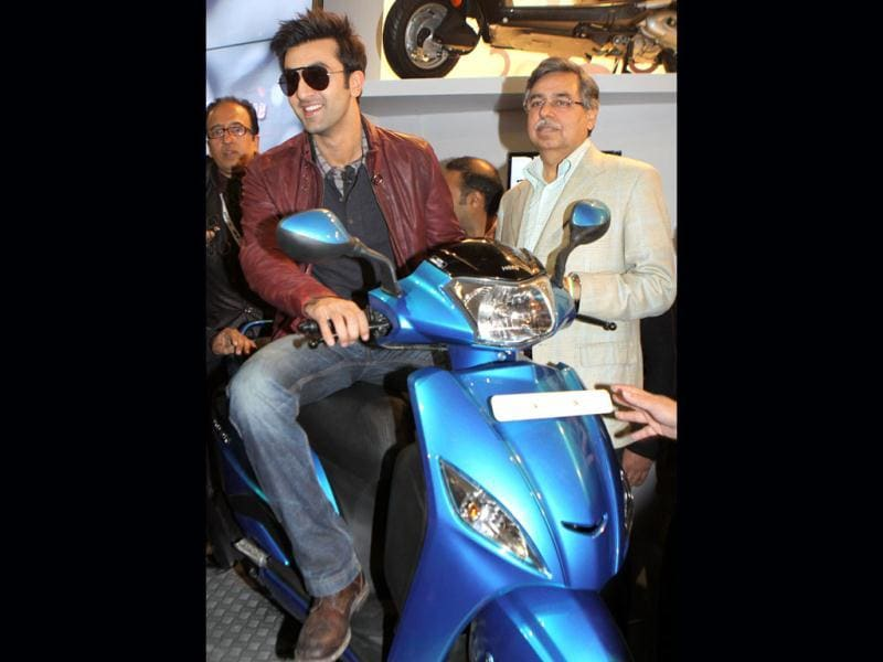 Ranbir Kapoor with MD, Hero MotoCorp, Pawan Munjal poses with the Leap scooty at the 11th Auto Expo 2012 at Pragati Maidan in New Delhi. PTI Photo