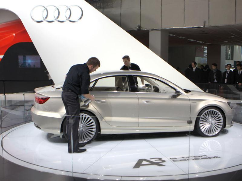 A worker cleans Audi's Concept A3 car at the Audi pavilion at Auto Expo 2012 in Pragati Maidan, New Delhi. HT Photo/Sonu Mehta