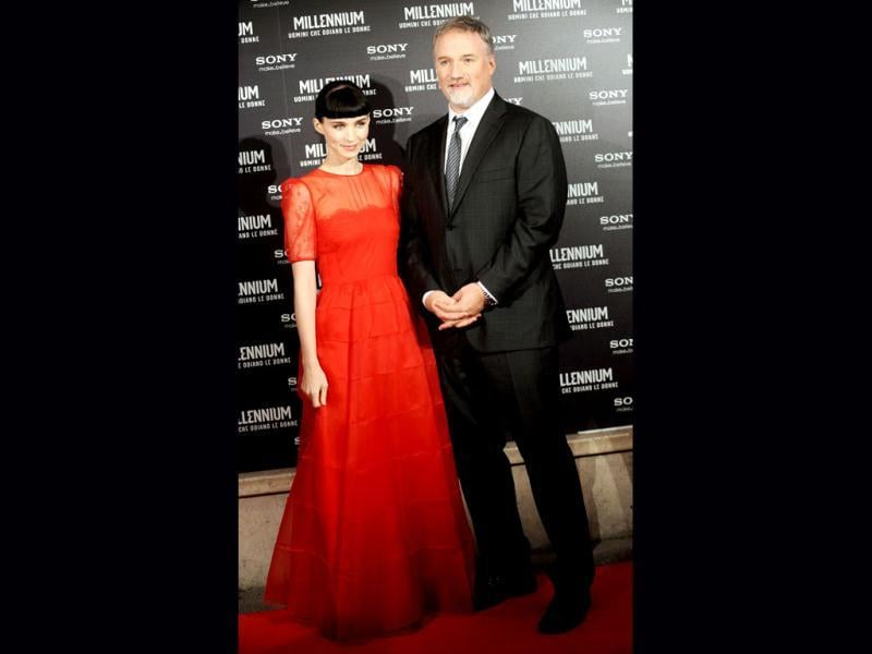 US director David Fincher and actor Rooney Mara pose as they arrive at the Italian premiere of their film.