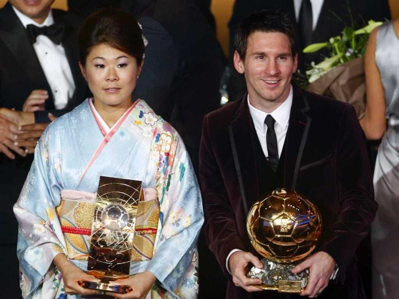 Homare Sawa of Japan (L), FIFA Women's World Player of the Year and Lionel Messi of Argentina, FIFA World Player of the Year pose with their FIFA Ballon d'Or 2011 trophy during the FIFA Ballon d'Or 2011 soccer awards ceremony at the Kongresshaus in Zurich. REUTERS/Christian Hartmann