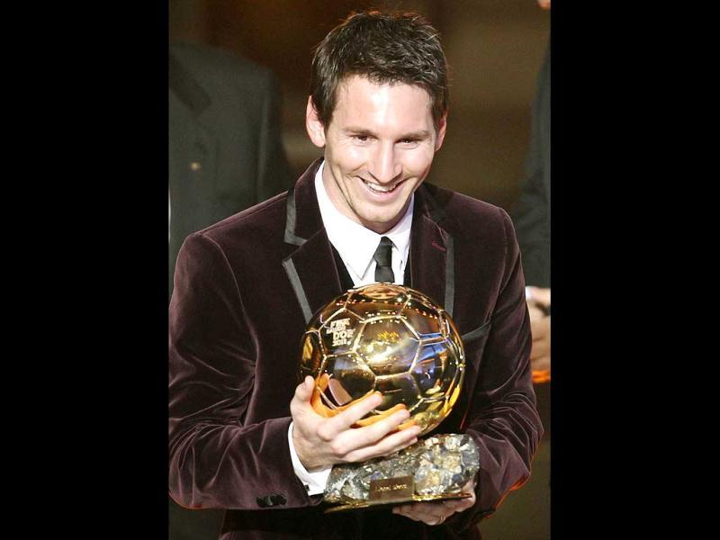 Argentina's Lionel Messi is awarded the prize for the soccer player of the year 2011 at the FIFA Ballon d'Or awarding ceremony in Zurich, Switzerland. (AP Photo/Michael Probst)