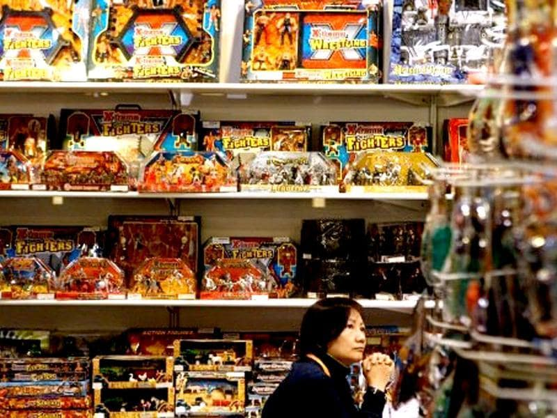 A vendor waits for customers at a stall during the Hong Kong toys and games fair. AFP Photo