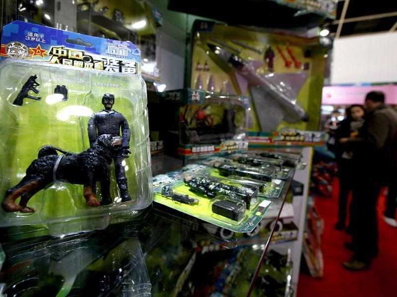 Toy figures and military weapons are displayed at a booth of the Toys & Games Fair in Hong Kong. AP Photo