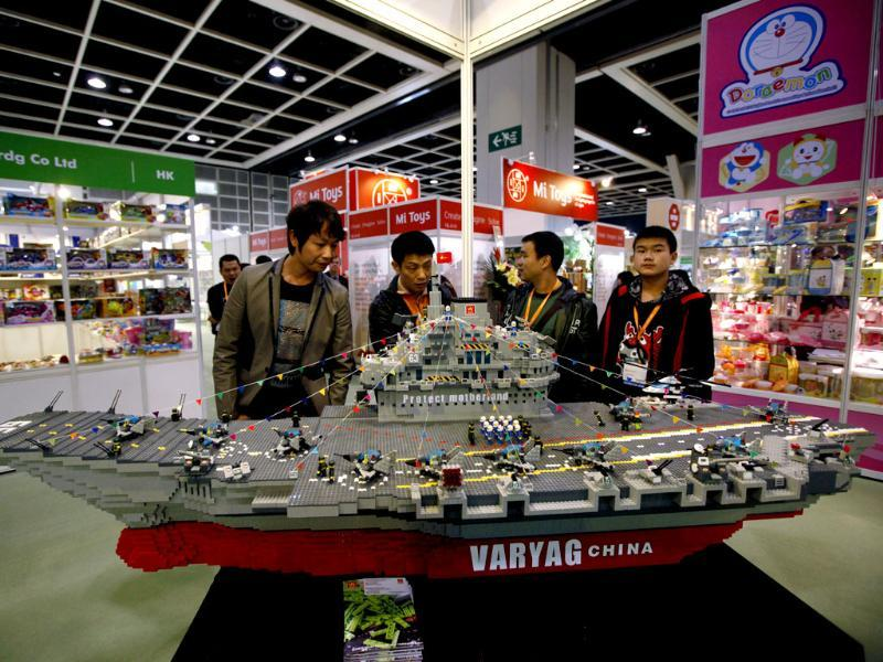 A model of China's first aircraft carrier, the former 'Varyag' of Ukraine made by building block bricks, is displayed at a booth during the Toys & Games Fair in Hong Kong. AP Photo