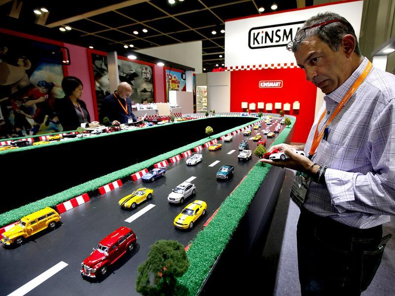 A visitor checks out toy cars at a booth during the Toys & Games Fair in Hong Kong. AP Photo
