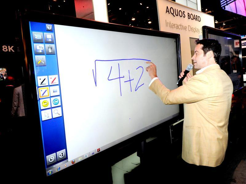 Tim Noonan demonstrates a Sharp Aquos Interactive Display System prototype on a 1080p full-HD, 70-inch LED/LCD at the Sharp Electronics booth on the opening day of the 2012 International Consumer Electronics Show in the Las Vegas. Ethan Miller/Getty Images/AFP