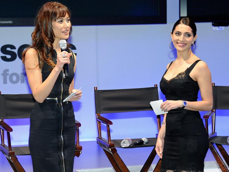 Actor Olga Kurylenko (L) and Caterina Murino,