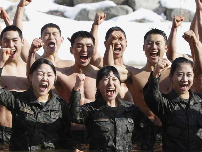 Members of the Special Warfare Command shout in frozen water during an annual severe winter season drill during a photo opportunity for the media in Pyeongchang, about 180 km (111 miles) east of Seoul. Reuters