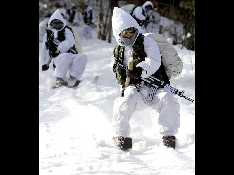 Members of the Special Warfare Command take part in an annual severe winter season drill during a photo opportunity for the media in Pyeongchang. The special forces carry out the training course every year to improve their members' combat abilities in cold weather and heavy snowfall. Reuters