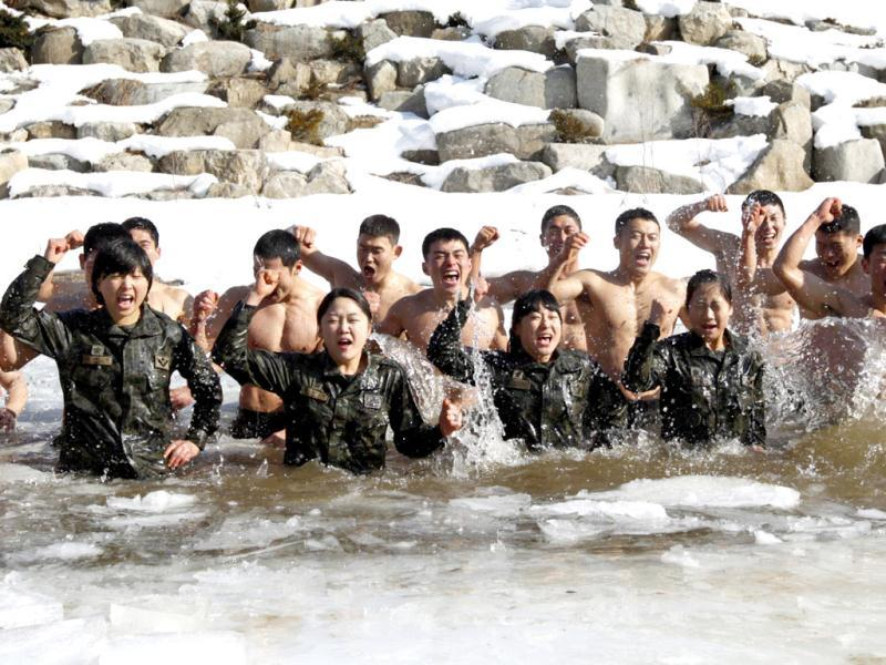 Members of the Special Warfare Command take a cold bath during an annual severe winter season drill during a photo opportunity for the media in Pyeongchang. Reuters