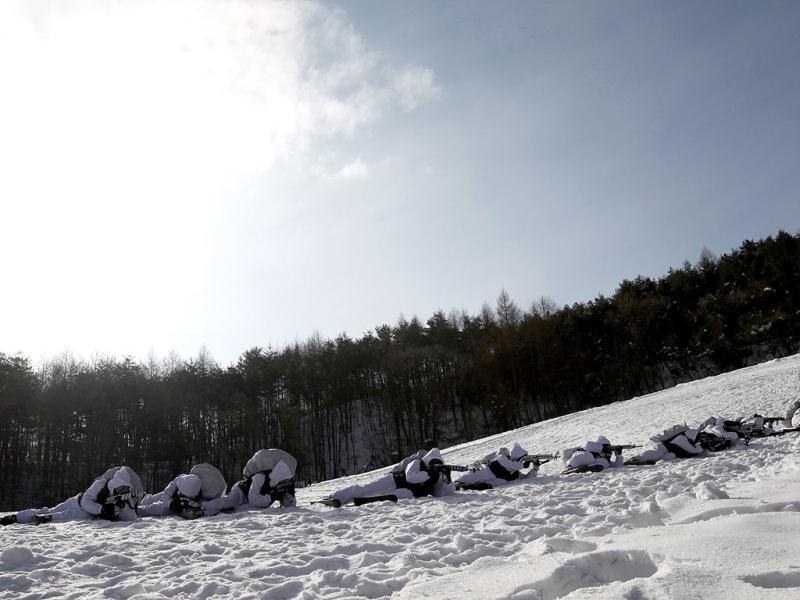 Members of the Special Warfare Command take part in an annual severe winter season drill during a photo opportunity for the media in Pyeongchang. Reuters