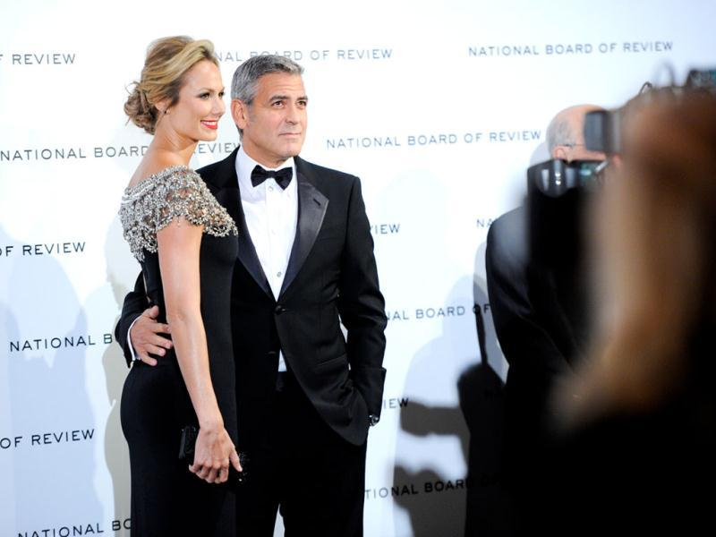 The winner and his arm candy: George Clooney with girlfriend Stacy Keibler. (AP)
