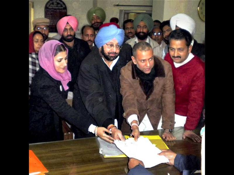 Congress candidate Arvind Khanna files his nomination papers from Dhuri assembly seat in presence of PPCC chief Capt. Amarinder Singh, in Sangrur. PTI Photo