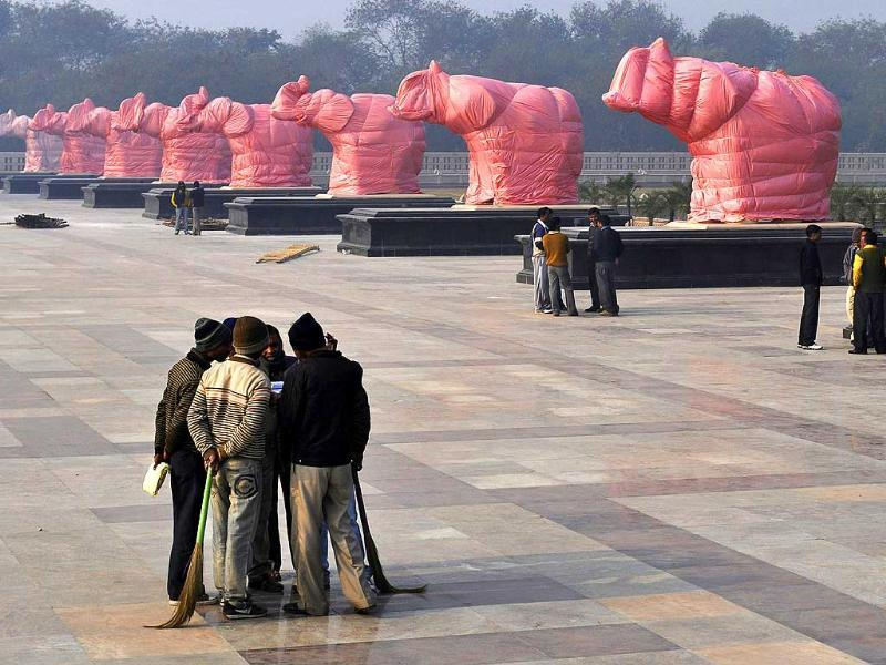 Covered elephant statues stand at Ambedkar Park in Noida, on the outskirts of New Delhi, India. AP Photo/Tsering Topgyal.