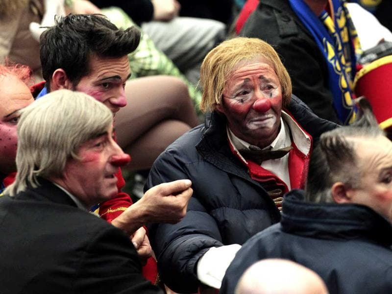 Clowns of an Italian circus wait for the start of Pope Benedict XVI's general audience in the Paul VI hall at the Vatican. AP Photo/Gregorio Borgia.