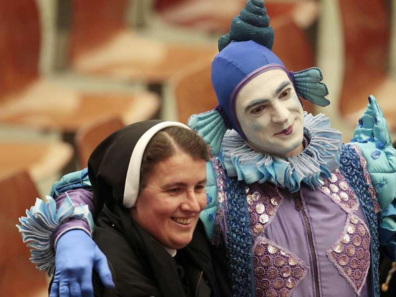 A clown of an Italian circus poses with a nun for a souvenir picture at the end of Pope Benedict XVI's general audience in the Paul VI hall at the Vatican. AP Photo/Gregorio Borgia.