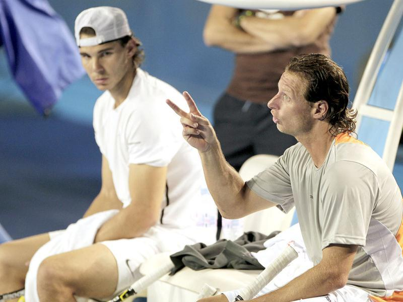 Argentina's David Nalbandian gestures as he sits with Spain's Rafael Nadal during a break in their practice session for the Australian Open tennis championship, in Melbourne, Australia. AP