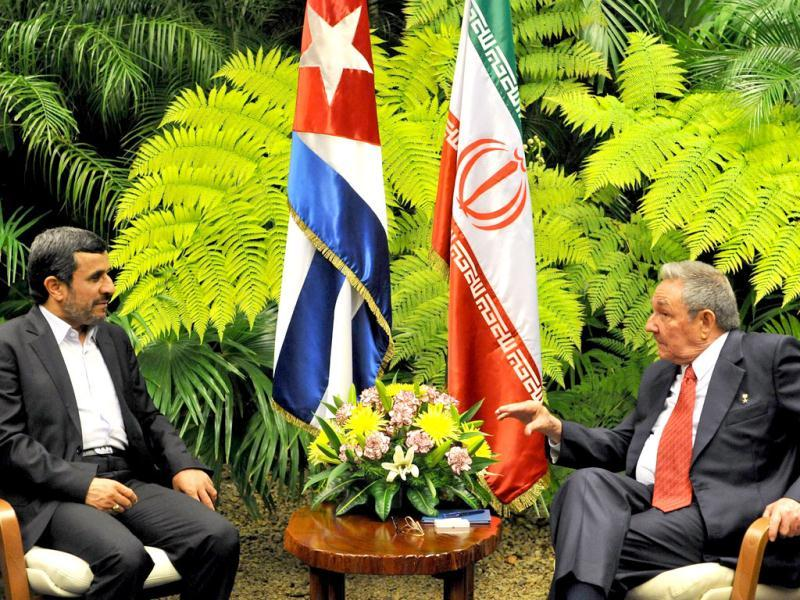 Iranian President Mahmoud Ahmadinejad (L) and his Cuban counterpart Raul Castro (R) talk during a meeting at State Council in Havana. Ahmadinejad The Iranian leader arrived in Cuba for talks with Castro as the Islamic republic blamed Israel and the United States for the killing of a nuclear scientist in a Tehran car bombing. AFP