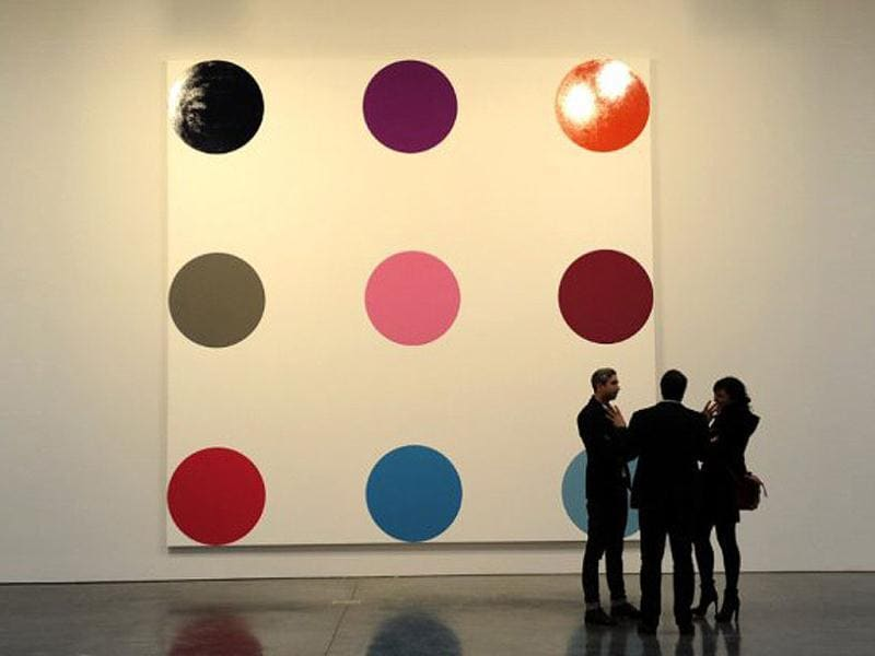 A painting titled Myristyl Acetate by artist Damien Hirst during a media preview of The Complete Spot Paintings 1986–2011 by artist Damien Hirstat at the Gagosian Gallery in New York. AFP/Timothy A Clary
