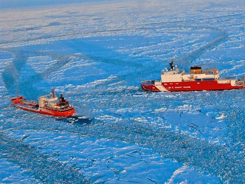 The Coast Guard Cutter Healy, right, approaches the Russian-flagged tanker Renda while breaking ice around the vessel 97 miles south of Nome, Alaska. AP photo