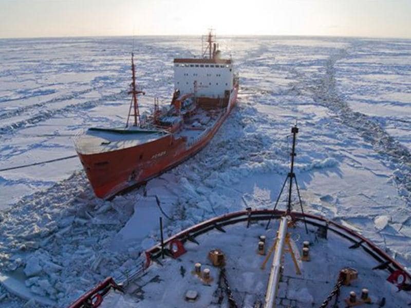 The Russian-flagged tanker Renda, carrying more than 1.3 million gallons of fuel, sits in the ice while the Coast Guard Cutter Healy crew breaks the ice around the tanker approximately 19 miles northwest of Nunivak Island. AP photo