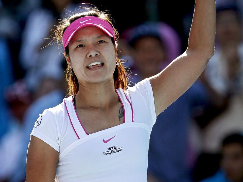 Li Na of China acknowledges the crowd after winning her semi-final match against Petra Kvitova of the Czech Republic at the Sydney International tennis tournament. Reuters
