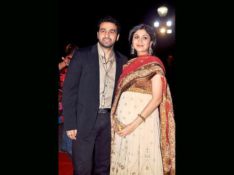 Raj poses with his much-pregnant wife.