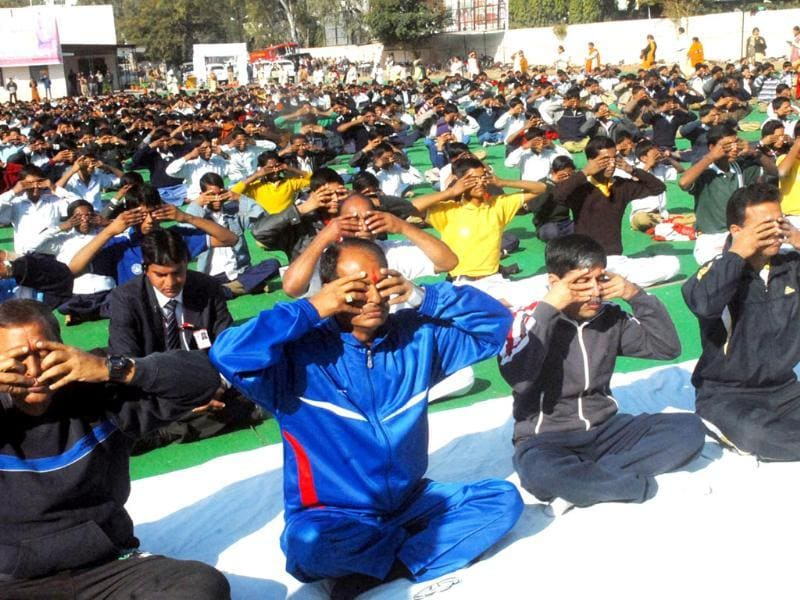 Madhya Pradesh chief minister Shivraj Singh Chouhan with students participates in surya namaskar programme, in Bhopal, to mark the birth anniversary of Swami Vivekanand celebrated as Youth Day across the country.