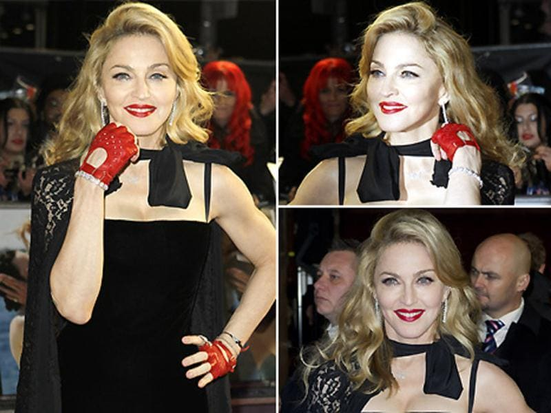 Dressed in a Jean Paul Gaultier velvet gown, Dolce & Gabbana lace cape and red fingerless gloves, US singer-songwriter Madonna looked startling at the UK premiere of her film W.E.