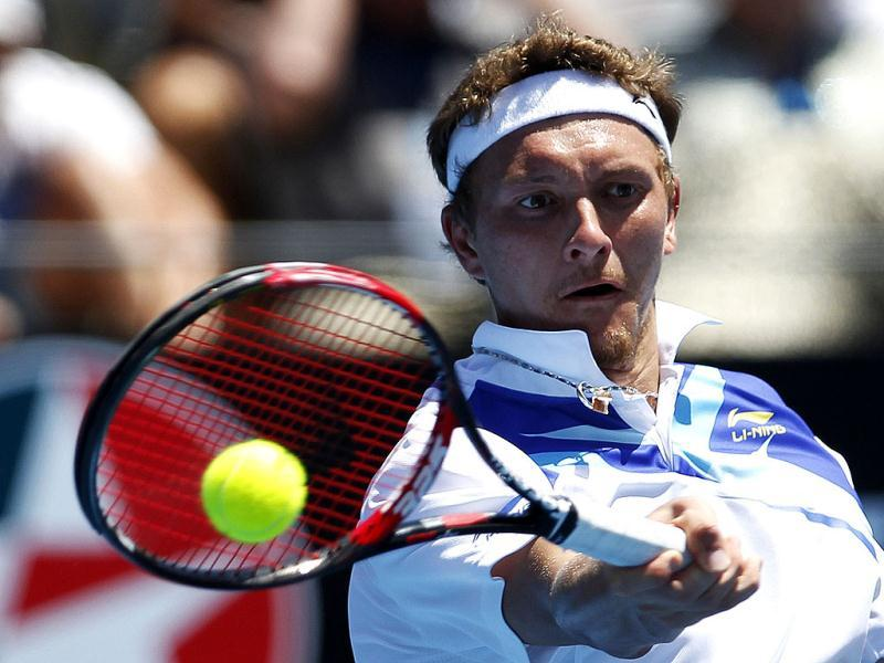 Denis Istomin of Uzbekistan hits a return to Jarkko Nieminen of Finland during their semi-final match at the Sydney International tennis tournament. Reuters