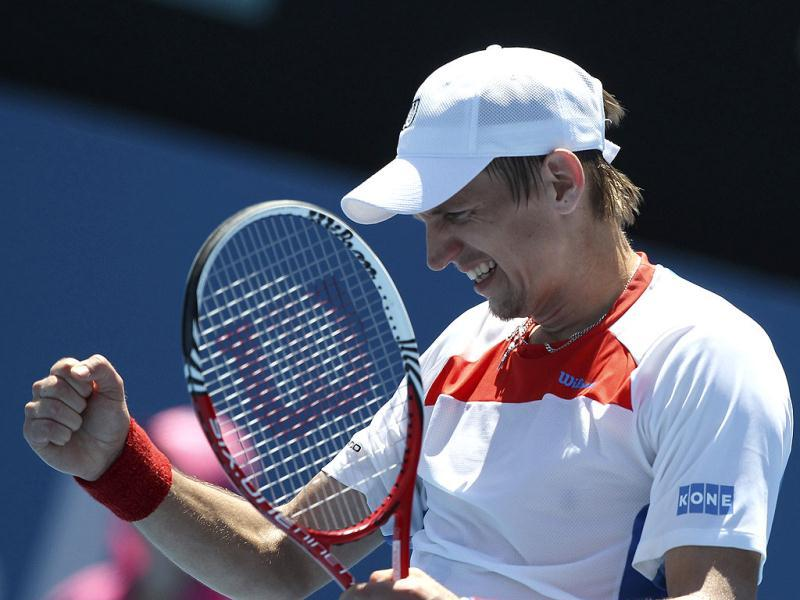 Jarkko Nieminen of Finland celebrates winning his semi finals match against Denis Istomin of Uzbekistan on the sixth day of play at the Sydney International tennis tournament in Sydney. AP