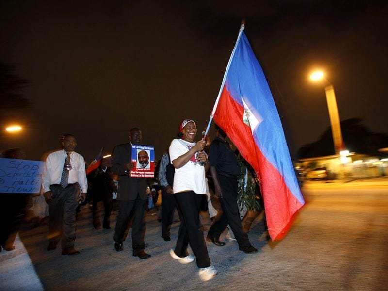 Haitian-Americans march down a street in the Little Haiti neighborhood of Miami in remembrance of those killed in the Jan. 12, 2010 earthquake in Haiti. AP