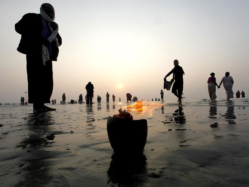 Pilgrims gather on the banks of the holy river Ganga at the Gangasagar some 155km south of Kolkata. Ascetics and pilgrims are making the annual trip to Sagar island for a holy dip, at the confluence of the Ganges river and the Bay of Bengal, during the one-day festival of Makar Sankranti. Reuters photo/Rupak De Chowdhuri