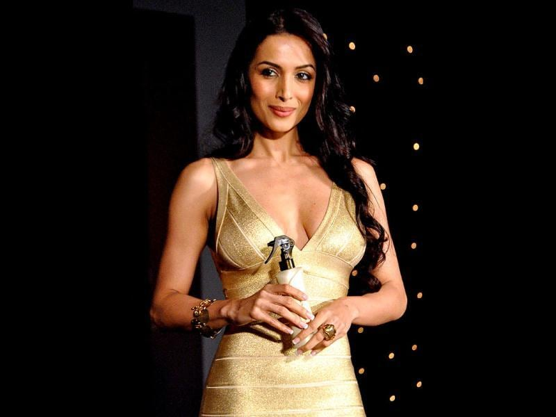 Malaika poses with the new Sunsilk gold.