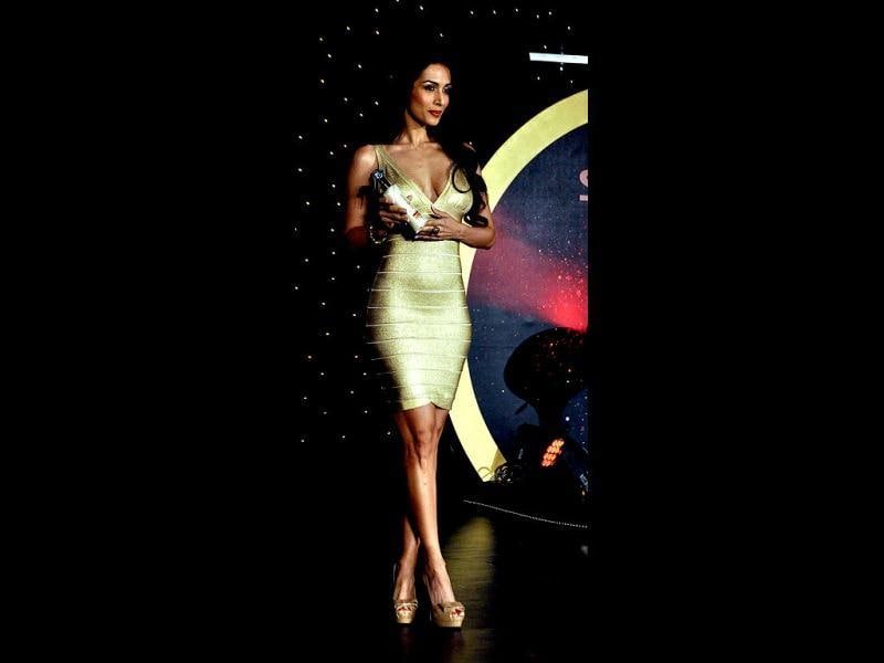 Malaika looks hot in a gold skin-hugging dress.