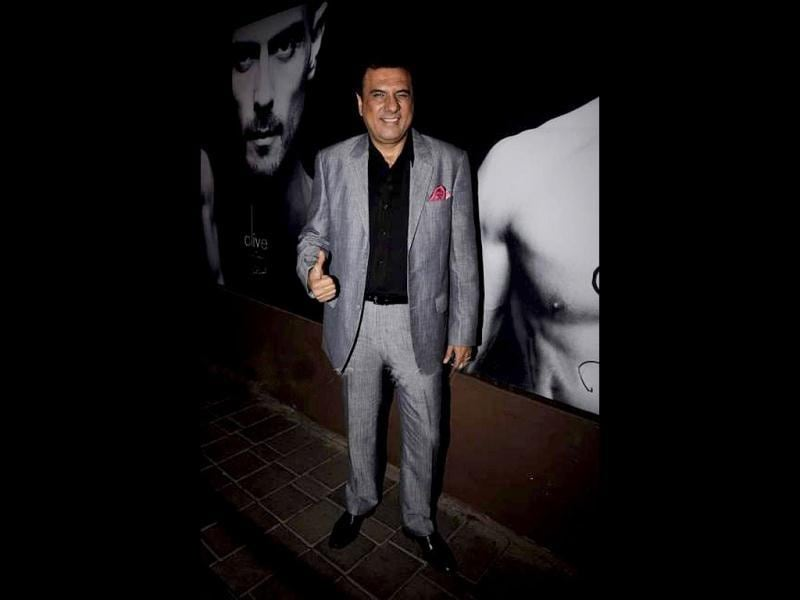 Boman Irani looks cheerful as he attends the perfume launch.