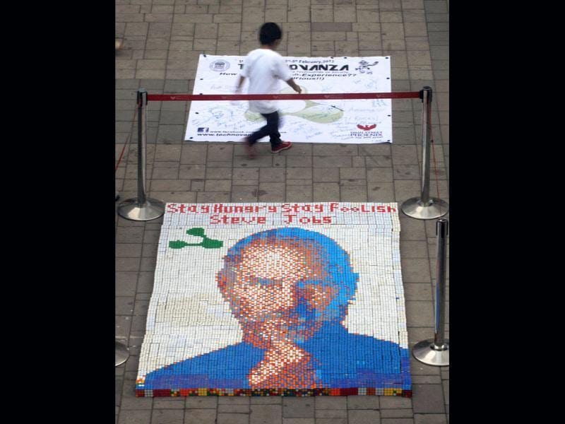 A portrait of late Apple co-founder Steve Jobs, made from some 1,500 Rubik's cubes, is seen on display at the High Street Phoenix Mall in Mumbai. AFP Photo