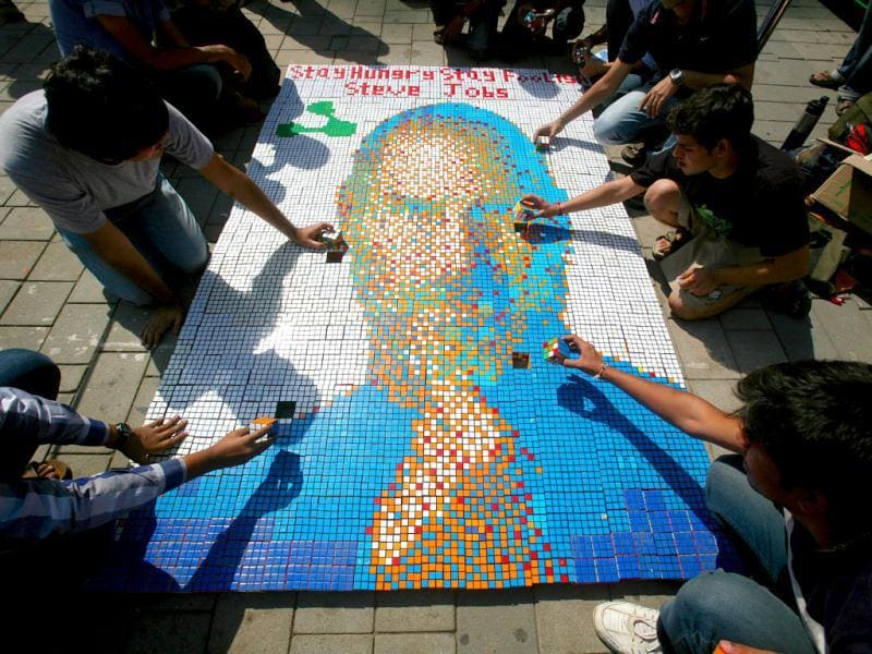 Students work on a picture of Steve Jobs at High Street Phoenix Courtyard as a part of Annual Techfest 'Technovanza 2012'. HT Photo/Kalpak Pathak