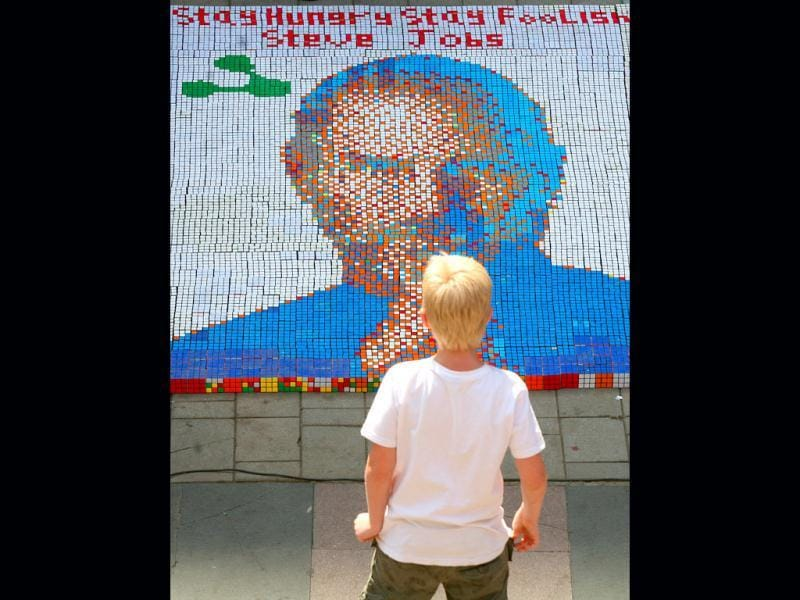 A young boy watches a picture of late Apple co-founder Steve Jobs, made up of 1500 Rubik's cubes in 3 hours by 10 students of VJTI as a part of Annual Techfest 'Technovanza 2012', at High Street Phoenix Courtyard in Mumbai. HT Photo/Kalpak Pathak