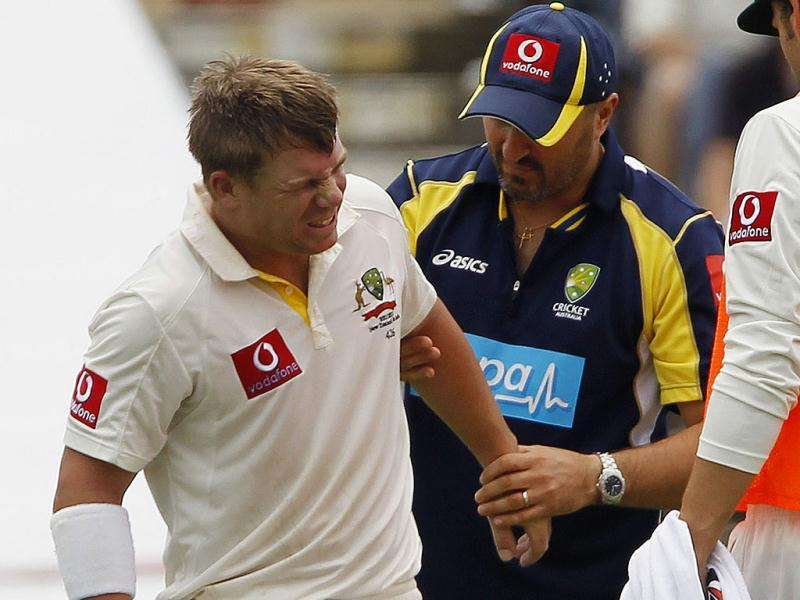 David Warner grimaces after being hit on the arm by the ball during the second day of the third cricket Test against India at the WACA in Perth. Reuters